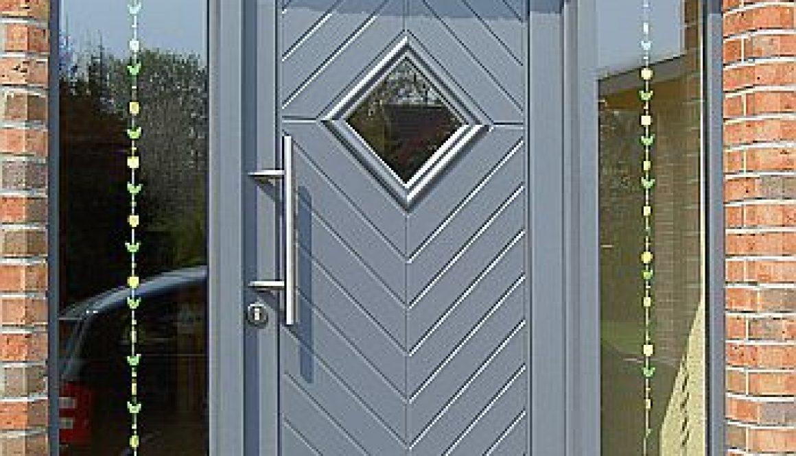 porte pvc gris avec panneau 3 vantails